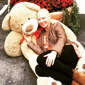 emilee with giant teddy bear